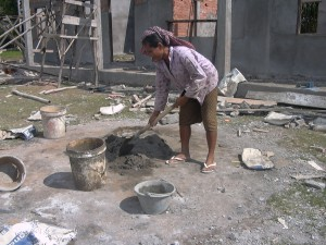 Lady mixing cement